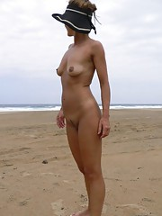 Wife shows off her ass and shaved cunt at a nude beach