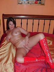 Hot skanky amateur MILF in red latex boots