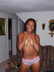 Ebony coed strips and fingers her cunt in photo collection