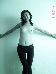 Chinese GF posing topless for her horny lover at home