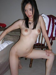 Korean hottie self-shooting naked in the bedroom