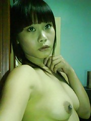 Petite Asian chick teasing and self-shooting naked