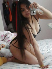 Sexy amateur Asian hottie camwhoring in her bedroom