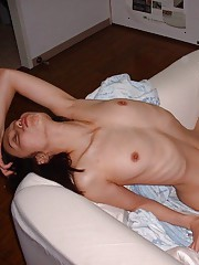 Naughty naked Oriental bitch posing for her boyfriend