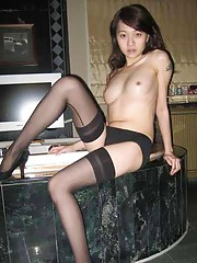 Picture collection of an amateur Thai GF getting kinky in a motel room