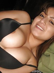 Busty senorita showing off her big round breasts