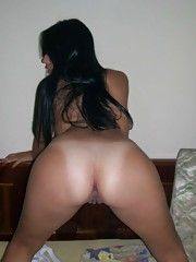 Latina strips and spreads her legs for her lover