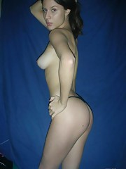 Brown-eyed Latina babe posing nude in her bedroom