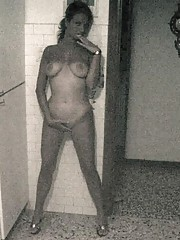 Nude Latina girlfriend posing around the house