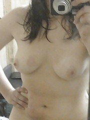Chubby brunette GF gets naked while selfshooting