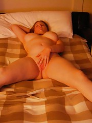 Naughty nude BBW showing off her curves in bed