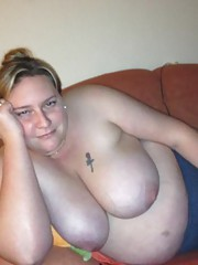 Amateur plumper displaying her big fat tits at home