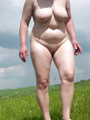 Horny wild chunky bitch gets naked outdoors