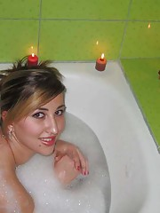 Picture selection of an amateur chubby hottie posing in a bath tub