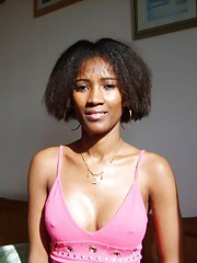 Ebony girlfriend posing bra less around the house