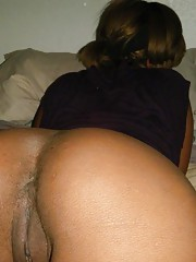 Ebony girlfriend shows off her perfect booty and shaved twat