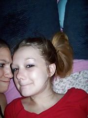 Horny lesbo teens teasing each other on the bed