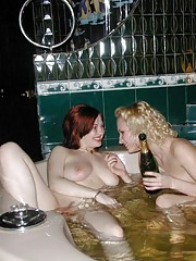 A redhead and a blonde having some lesbian fun