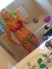 Inked and pierced blonde babe camwhoring in the house