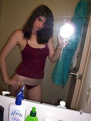 Photos of a cute GF selfshooting in the bathroom mirror
