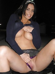Slutty bitch flashing her round breasts and shaved cunt
