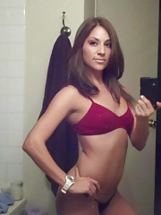 Sexy brunette self-shoots naked in front of the mirror