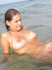 Photo gallery of an amateur sexy naughty topless babe posing outdoors